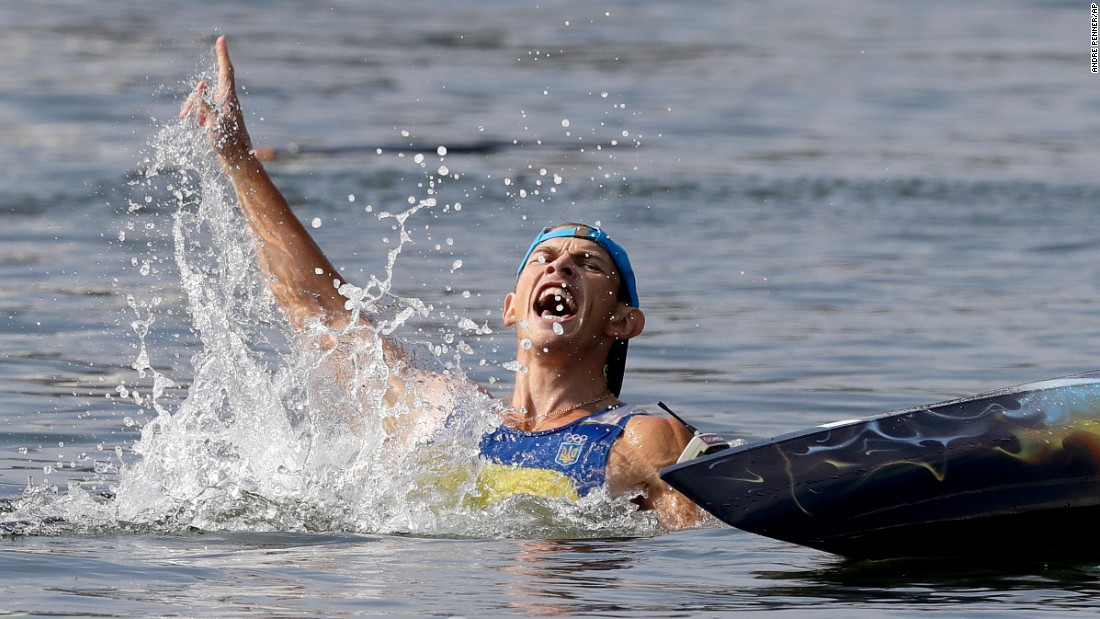 Ukrainian canoeist Yuriy Cheban celebrates gold in the C-1 200-meter sprint.