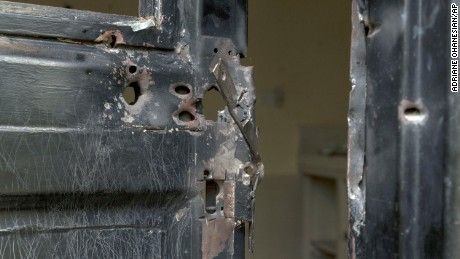 In this photo taken Wednesday, Aug. 3, 2016 and released by Adriane Ohanesian, bullet holes are seen in a metal door that was shot open at the Terrain compound after it was looted the previous month in the capital Juba, South Sudan. On July 11, South Sudanese troops, fresh from winning a battle in Juba over opposition forces, went on a nearly four-hour rampage through a residential compound popular with foreigners, in one of the worst targeted attacks on aid workers in South Sudan's three-year civil war. (Adriane Ohanesian via AP)