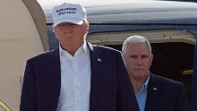 Republican presidential candidate Donald Trump, followed by running mate, Indiana Gov. Mike Pence, emerges from his plane as he arrives to tour the flood damaged city of Baton Rouge, La., Friday, Aug. 19, 2016.