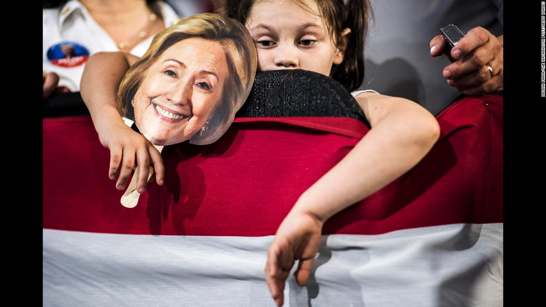 A girl attends a Hillary Clinton rally at a Cleveland high school on Wednesday, August 17.