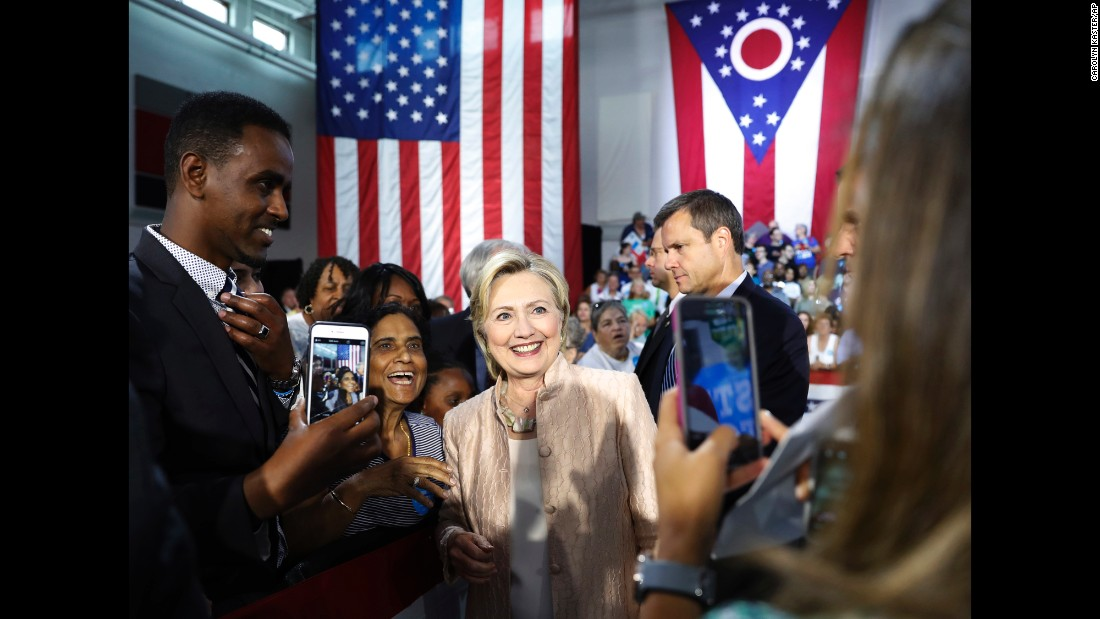 Democratic presidential nominee Hillary Clinton poses for photos after speaking in Cleveland on Wednesday, August 17.