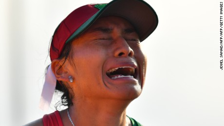 Mexico's Maria Guadalupe Gonzalez reacts after winning the silver medal in the Women's 20km Race Walk during the athletics event at the Rio 2016 Olympic Games in Pontal in Rio de Janeiro on August 19, 2016.   / AFP / Jewel SAMAD        (Photo credit should read JEWEL SAMAD/AFP/Getty Images)