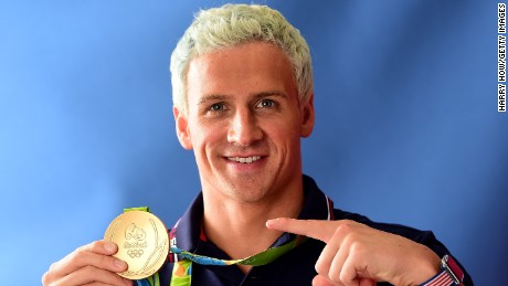 RIO DE JANEIRO, BRAZIL - AUGUST 12:  (BROADCAST - OUT) Swimmer, Ryan Lochte of the United States poses for a photo with his gold medal on the Today show set on Copacabana Beach on August 12, 2016 in Rio de Janeiro, Brazil.  (Photo by Harry How/Getty Images)