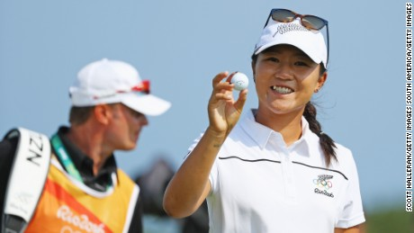 Lydia Ko of New Zealand poses with the golf ball she used to make a hole-in-one in Rio.
