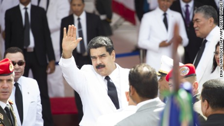 Venezuelan president Nicolas Maduro waves on arrival at the National Congress for the inauguration of President Danilo Medina, in Santo Domingo on August 16, 2016.  / AFP / afp / Erika SANTELICES        (Photo credit should read ERIKA SANTELICES/AFP/Getty Images)