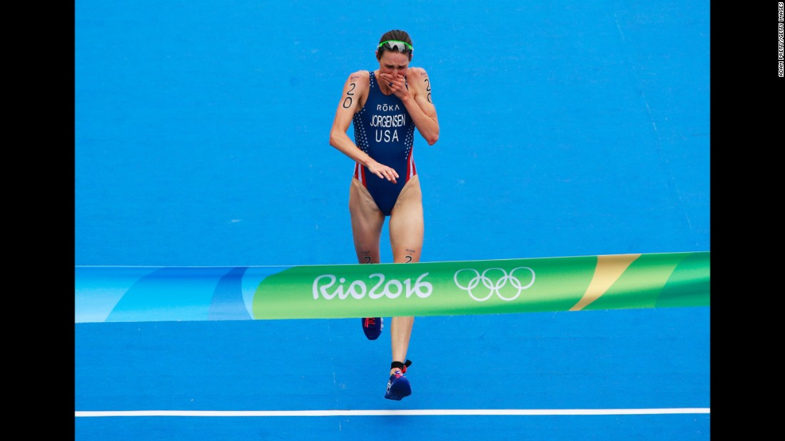 U.S. triathlete Gwen Jorgensen reacts as she crosses the finish line. This is the first time the United States has won gold in the triathlon.
