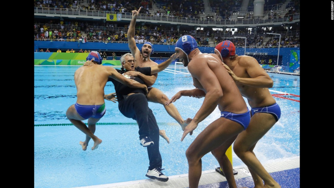 Italian water polo players celebrate with their coach Alessandro Campagna after defeating Montenegro in the bronze medal game.