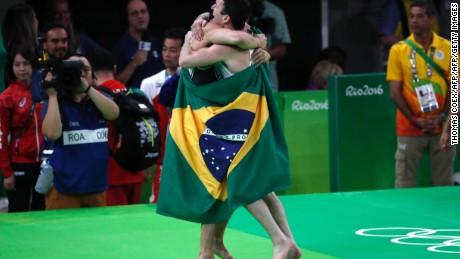 Brazil's Arthur Mariano (L) and Diego Hypolito celebrate in style
