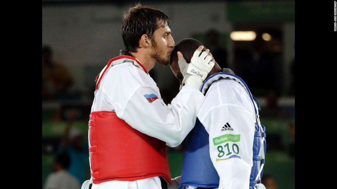 Radik Isaev of Azerbaijan, left, kisses Great Britain's Mahama Cho after defeating Cho in the over 80-kilogram (176-pound) semifinal taekwondo event.