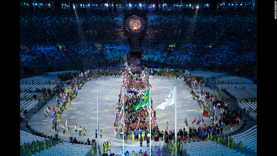 Athletes enter the stadium.