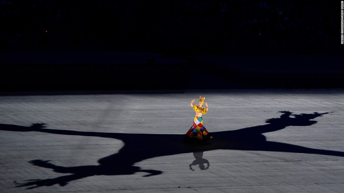 A dancer performs during the closing ceremony.