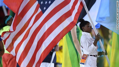 USA's flag-bearer Simone Biles holds her country's national flag during the closing ceremony of the Rio 2016 Olympic Games at the Maracana stadium in Rio de Janeiro on August 21, 2016. / AFP / Leon NEAL        (Photo credit should read LEON NEAL/AFP/Getty Images)