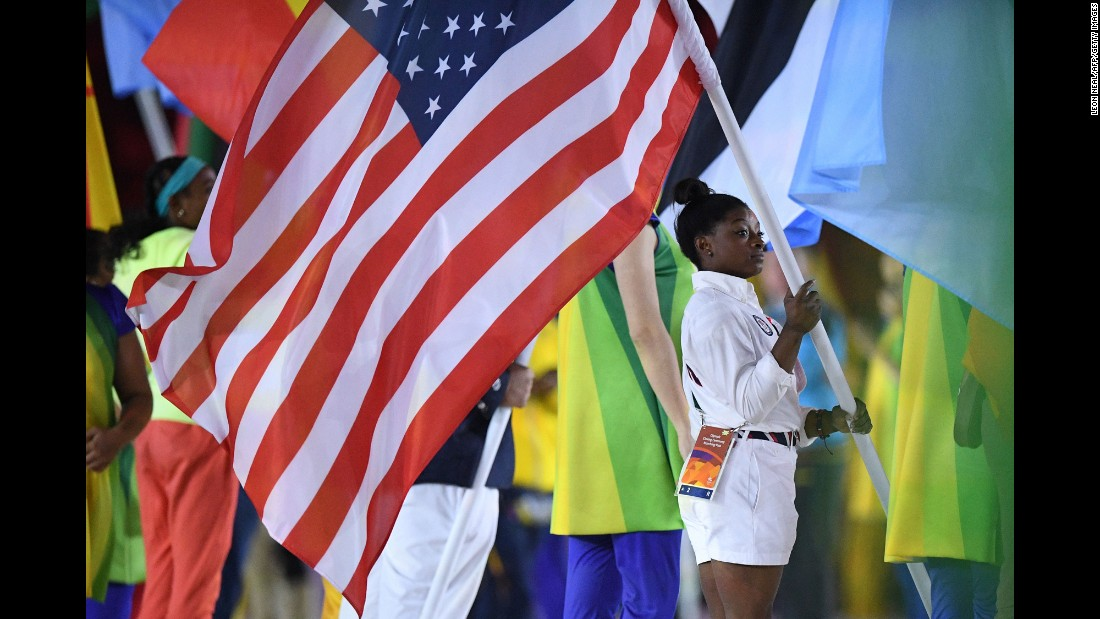 US gymnast Simone Biles holds the American flag.