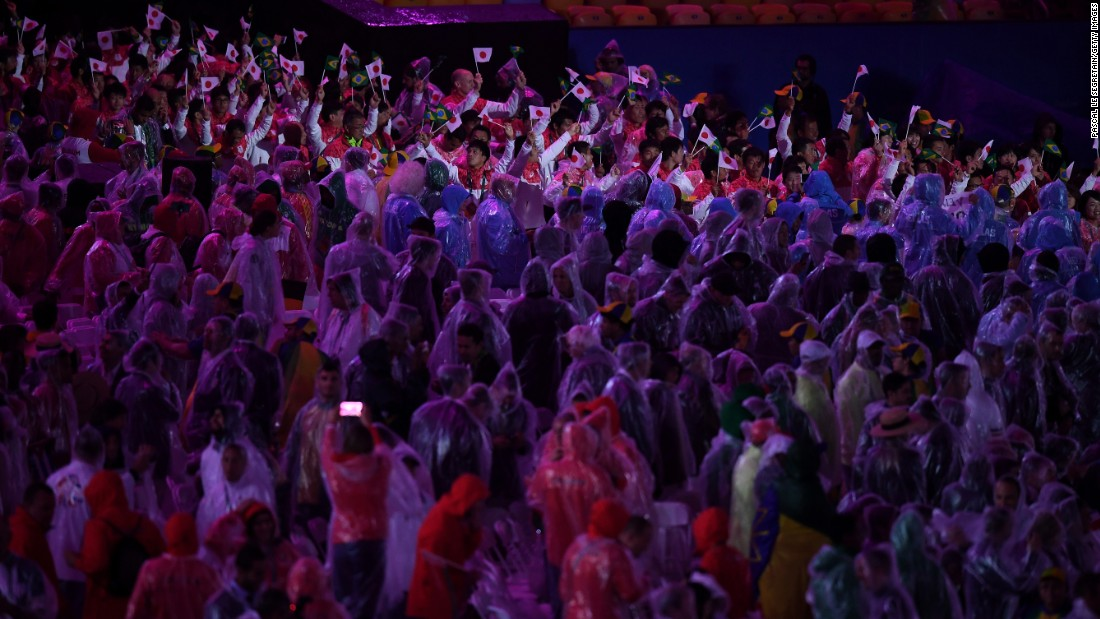 """Athletes from Japan march during the """"Heroes of the Games"""" segment."""