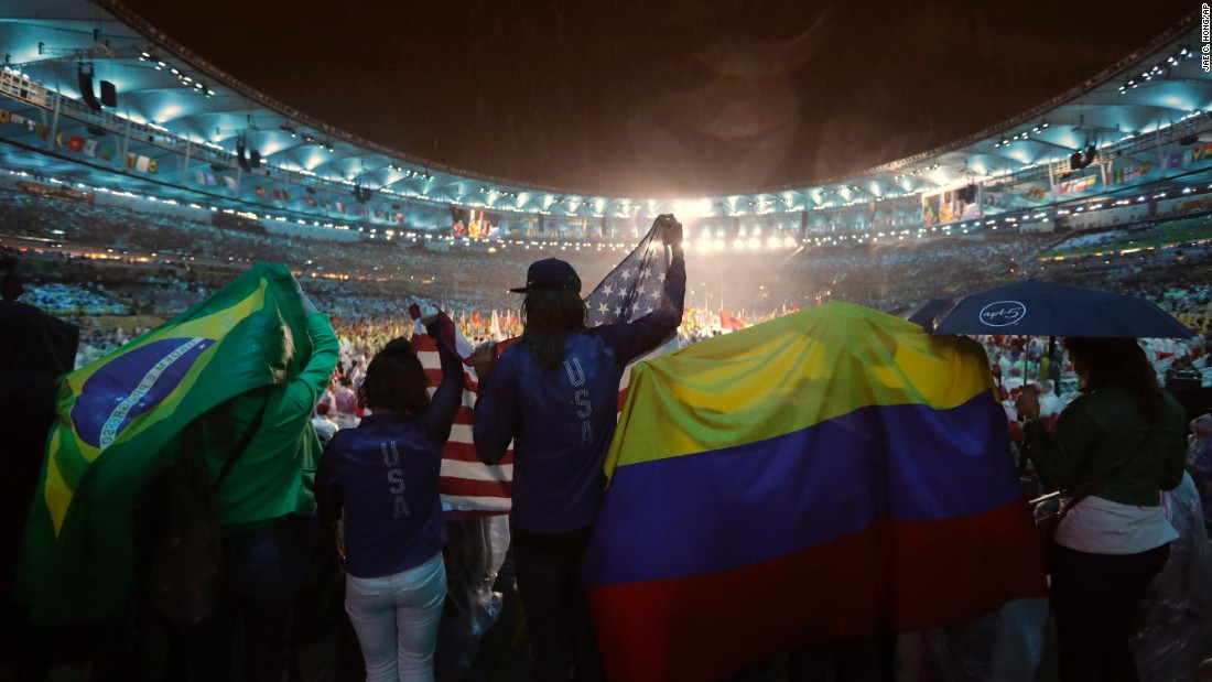 People wave flags from Brazil, the United States and Colombia during the Olympics closing ceremony at Maracana stadium in Rio de Janeiro on Sunday, August 21.