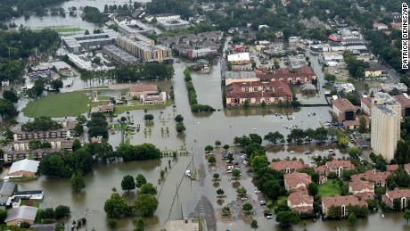 This aerial image shows flooded areas on the campus of LSU, Saturday, Aug. 13, 2016, in Baton Rouge, La. Louisiana Gov. John Bel Edwards says more than 1,000 people in south Louisiana have been rescued from homes, vehicles and even clinging to trees as a slow-moving storm hammers the state with flooding.