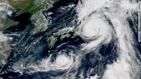 Typhoons Mindulle and Lionrock sit off the Japanese coast on Monday