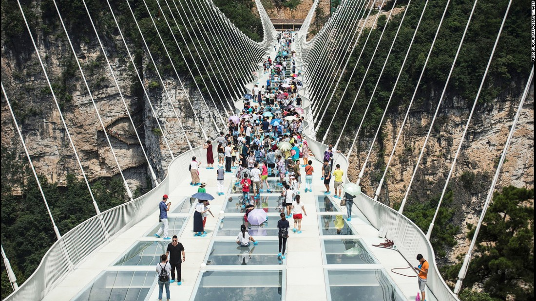"On August 20, China opened the world's highest and longest glass-bottomed bridge in Zhangjiajie in China's Hunan Province. It has closed 13 days later, due to ""overwhelming demand."""