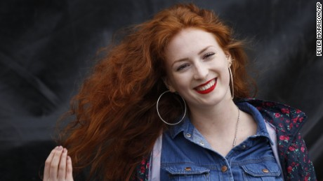 IMAGE DISTRIBUTED FOR THE IRISH REDHEAD CONVENTION - Molly Murphy winner of the Porcelain skin redhead on day 2 of the Irish Redhead Convention, Saturday, Aug. 20, 2016 at Crosshaven, Co. Cork, Ireland. Over 40 ginger themed events take place over the three day festival including the coronation of the new Redhead King & Queen, redhead seminars, exhibitions, group photos, parade of natural redheads, ginger speed dating and prizes for the most freckles per square inch. The Irish Redhead Convention are charity partners to the Irish Cancer Society, promoting a message for all redheads and fair skinned folk to cover up, wear sunscreen and be safe in the sun. Find out more on redheadconvention.ie. (Peter Morrison/AP Images for the Irish Redhead Convention)
