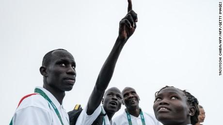 South Sudan's athletes James Nyang Chiengjiek (L), Yiech Pur Biel (2nd L) and Rose Nathike Lokonyen.