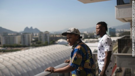 Refugees and judo athletes from the Democratic Republic of Congo Yolande Mabika, center, and Popole Misenga, right, take in the view from their future apartment at the Olympic Village.