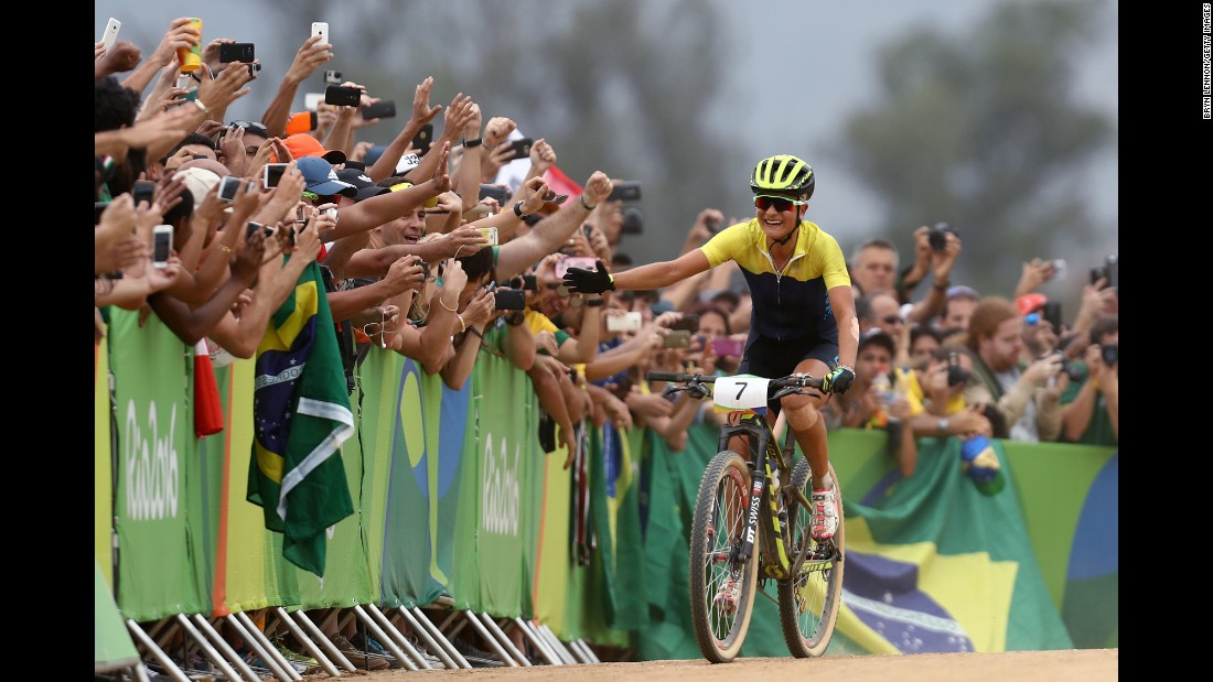 Sweden's Jenny Rissveds interacts with fans after winning the cross-country mountain bike race on Saturday, August 20.