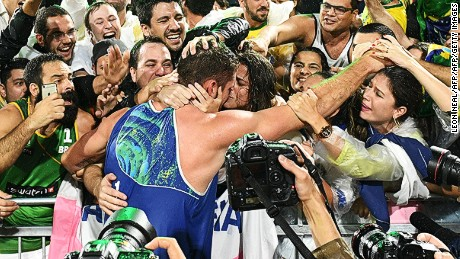Brazil's Alison Cerutti (C) celebrates after winning the men's beach volleyball final match between Italy and Brazil at the Beach Volley Arena in Rio de Janeiro late on August 18, 2016, for the Rio 2016 Olympic Games.  / AFP / Leon NEAL        (Photo credit should read LEON NEAL/AFP/Getty Images)
