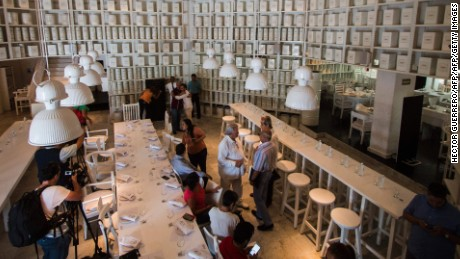 "Journalists see inside the restaurant ""La Leche"" (The Milk) on August 18, 2016 in Puerto Vallarta, Jalisco, western Mexico, from where Jesus Alfredo Guzman Salazar, son of drug lord Joaquin ""El Chapo"" Guzman, was kidnapped among other five clients Monday.  Seven gunmen in pickup trucks swooped on the upscale bar and restaurant Monday around dawn and abducted the victims. Investigators said it was likely part of a settling of scores between rival drug cartels. / AFP / HECTOR GUERRERO        (Photo credit should read HECTOR GUERRERO/AFP/Getty Images)"
