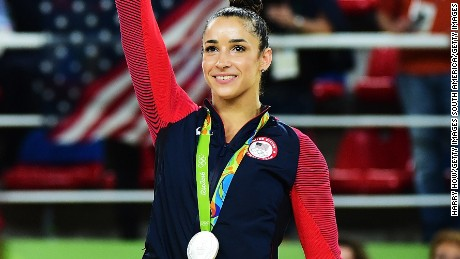 RIO DE JANEIRO, BRAZIL - AUGUST 11:  Silver medalist Alexandra Raisman of the United States celebrates on the podium at the medal ceremony for the Women's Individual All Around Final on Day 6 of the 2016 Rio Olympics at Rio Olympic Arena on August 11, 2016 in Rio de Janeiro, Brazil.  (Photo by Harry How/Getty Images)