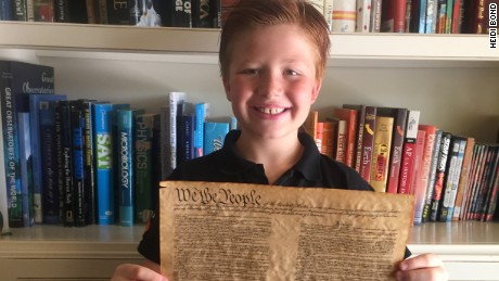 Nathan Bond holds up his favorite document -- the Constitution.