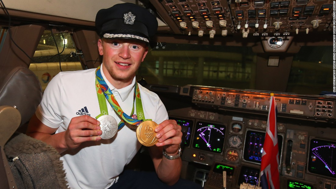 Adam Peaty led the way in Great Britain's gold rush with a new world record in the 100m breakstroke. Here he is posing with his medals on the flight deck.