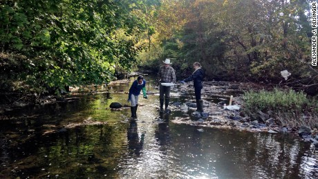 Sylvia Lee, Dan Dillon, and Joanna Blaszczak sampling in the Gwynns Falls at Dead Run. This field site is part of the Baltimore Ecosystem Study, an NSF funded urban Long-term Ecological Research Program