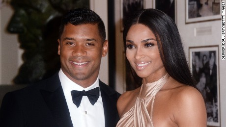 Russell Wilson from the Seattle Seahawks and Ciara Harris arrive for the State dinner in honor of Japanese Prime Minister Shinzo Abe And Akie Abe April 28, 2015 at the Booksellers area of the White House in Washington, DC.