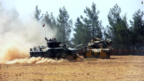 A Turkish army tank and an armored vehicle in Karkamis, near the Syrian border Tuesday.