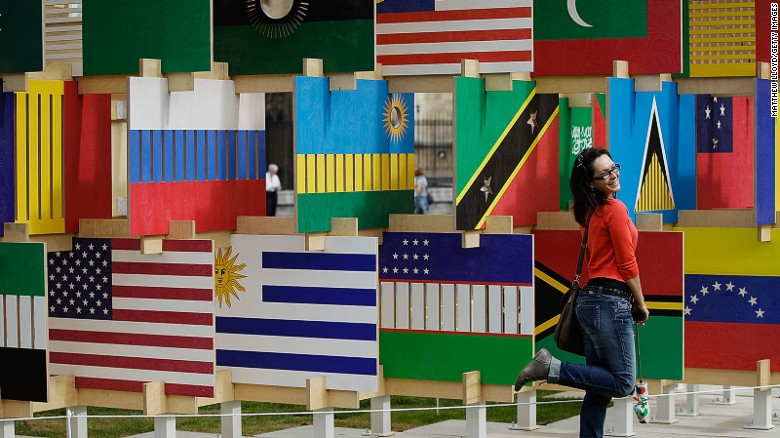 "A tourist poses in front of the ""House of Flags"" installation in London's Parliament Square in 2012."