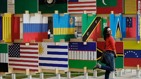 """A tourist poses in front of the """"House of Flags"""" installation in London's Parliament Square in 2012."""