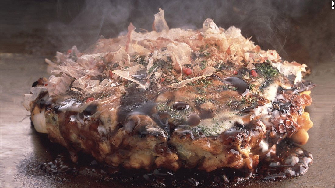 """Translating loosely as """"as you like it,"""" okonomiyaki is a savory pancake made with any number of ingredients -- thin slices of pork belly, octopus, shrimp and even cheese."""