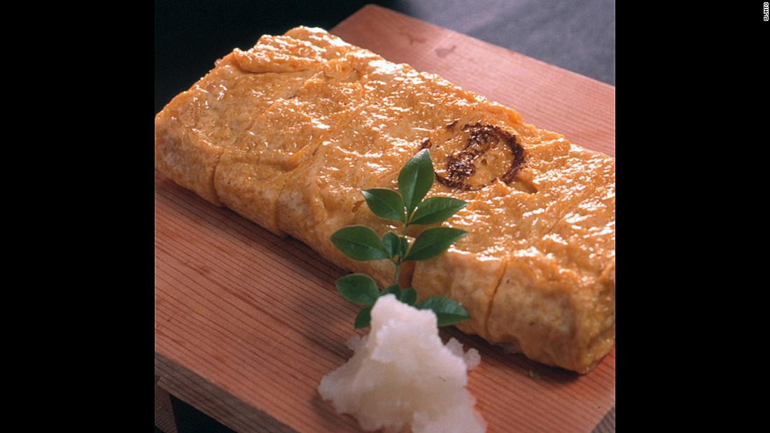 Tamagoyaki is made by rolling an egg mix -- with dashi -- into layers, then cutting into slices.