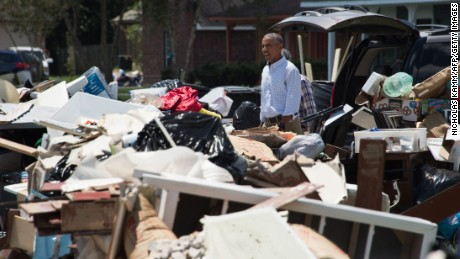 US President Barack Obama tours a flood-affected area in Baton Rouge, Louisiana, on Tuesday, August 23.