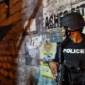 armed policeman in allyway (1 of 1)