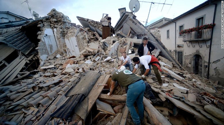 Residents search for victims in the rubble after a strong earthquake hit Amatrice, a town in central Italy, on August 24, 2016