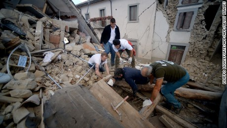 Resident search for victims in the rubble after a strong heartquake hit Amatrice on August 24, 2016.  Central Italy was struck by a powerful, 6.2-magnitude earthquake in the early hours, which has killed at least three people and devastated dozens of mountain villages. Numerous buildings had collapsed in communities close to the epicenter of the quake near the town of Norcia in the region of Umbria, witnesses told Italian media, with an increase in the death toll highly likely. / AFP PHOTO / FILIPPO MONTEFORTEFILIPPO MONTEFORTE/AFP/Getty Images