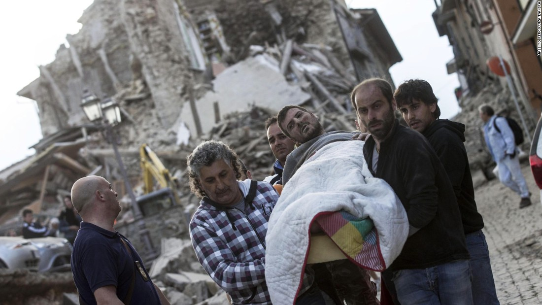 An injured man is rescued from a collapsed building in Amatrice on August 24.