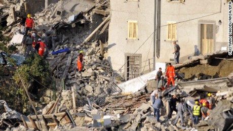 epa05508254 Search and rescue teams survey the rubble of collapsed buildings in Pescara del Tronto, near Arquata del Tronto municipality, Ascoli Piceno province, Marche Region, central Italy, 24 August 2016, following a 6.2 magnitude earthquake, according to the United States Geological Survey (USGS), that struck at around 3:30 am local time (1:30 am GMT). The quake was felt across a broad section of central Italy, including the capital Rome where people in homes in the historic center felt a long swaying followed by aftershocks. According to reports at least 21 people died in the quake, 11 in Lazio and 10 in Marche regions.  EPA/CRISTIANO CHIODI