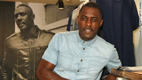 Idris Elba, wearing the Idris Elba + Superdry IE Ghost Button Down Denim Shirt, celebrates the launch of his new Boxpark retail space which will stock Idris Elba + Superdry exclusively on August 14 in London, England.