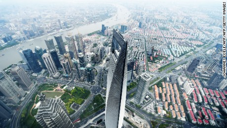This picture taken on May 8, 2015 shows a view of the Shanghai World Financial Center (C) from the 120th floor of the new Shanghai Tower, which is still under construction.  The 632-metre Shanghai Tower (2,073 ft) is expected to be completed in the summer of 2015.     AFP PHOTO / JOHANNES EISELE        (Photo credit should read JOHANNES EISELE/AFP/Getty Images)