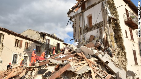 PERUGIA, ITALY - AUGUST 24:  Rescuers clear debris while searching for victims in damaged buildings on August 24, 2016 in Arquata del Tronto, Italy. Central Italy was struck by a powerful, 6.2-magnitude earthquake in the early hours, which has killed at least thirteen people and devastated dozens of mountain villages. Numerous buildings have collapsed in communities close to the epicenter of the quake near the town of Norcia in the region of Umbria, witnesses have told Italian media, with an increase in the death toll highly likely  (Photo by Giuseppe Bellini/Getty Images)
