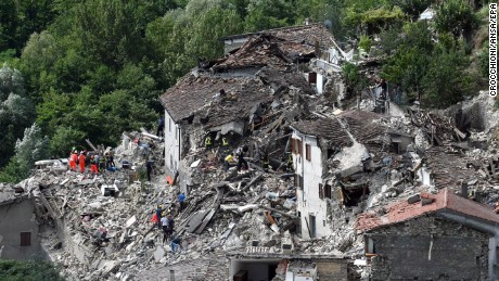 epa05508280 Search and rescue teams survey the rubble of collapsed and damaged houses in Pescara del Tronto, near Arquata del Tronto municipality, Ascoli Piceno province, Marche Region, central Italy, 24 August 2016, following a 6.2 magnitude earthquake, according to the United States Geological Survey (USGS), that struck at around 3:30 am local time (1:30 am GMT). The quake was felt across a broad section of central Italy, including the capital Rome where people in homes in the historic center felt a long swaying followed by aftershocks. According to reports at least 21 people died in the quake, 11 in Lazio and 10 in Marche regions.  EPA/CROCCHIONI