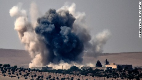 TOPSHOT - This picture taken from the Turkish Syrian border city of Karkamis in the southern region of Gaziantep, on August 24, 2016 shows smoke billows following air strikes by a Turkish Army jet fighter on the Syrian Turkish border village of Jarabulus during fighting against IS targets. Turkey's army backed by international coalition air strikes launched an operation involving fighter jets and elite ground troops to drive Islamic State jihadists out of a key Syrian border town. / AFP PHOTO / BULENT KILICBULENT KILIC/AFP/Getty Images