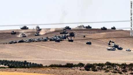 Turkish tanks and allied Syrian rebels move along the border Wednesday.